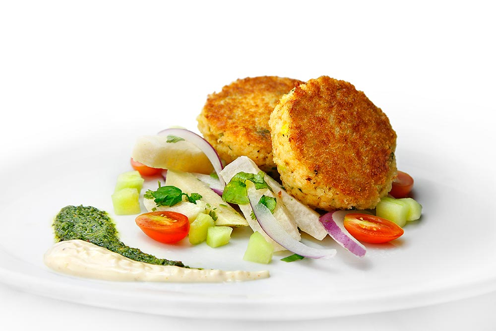 Coastside Crab Cakes With Jicama Cucumber Salad, Bay Spice Aioli And Chimichurri Sauce