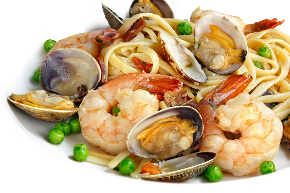 Linguine Di Mare Pasta With Prawns, Clams, Bacon, Peas And Tomatoes