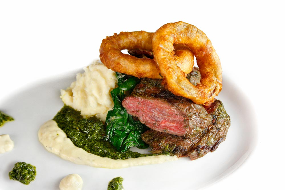 Char Grilled Skirt Steak With Chimichurri Sauce, Buttermilk Onion Rings, Mashed Potatoes And Sautéed Spinach
